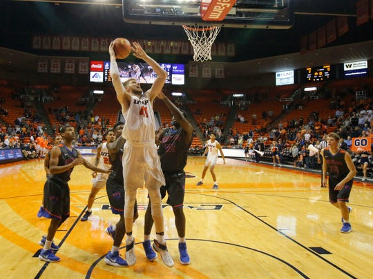 UTEP center Matt Wilms takes the ball to the basket during first half action against Louisiana College's Devon Washington. The Miners took a 48-16 lead into the locker room.