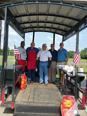 Lafayette Parish School Board members cooked lunch for administrators Monday at their annual conference. Pictured from left are board members Elroy Broussard, Britt Latiolais and Erick Knezek; Superintendent Donald Aguillard and board member Jeremy Hidalgo.