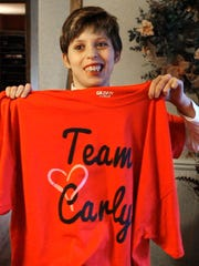 Carly Fetzer shows off a Team Carly T-shirt in this 2015 file photo.