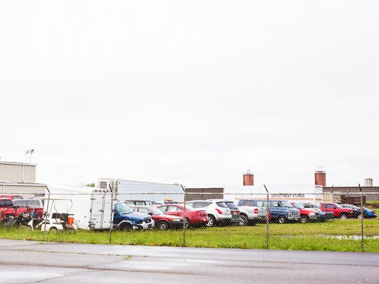 Dozens of cars are parked in the lot at Relevant Compounding LLC on State Route 220 in Waverly, Ohio Wednesday, May 11, 2016. The lot is being used as the command center for the investigation into the eight murders that occurred April 22, 2016. According to Leonard Manley, the cars were towed from the Rhoden's property.