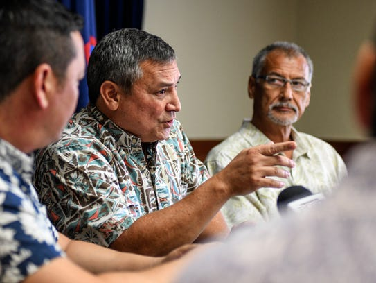 In this March 6 file photo, Gov. Eddie Calvo is flanked by members of his fiscal team at Adelup. Administration officials recently admitted taking money from a Chamorro Land Trust special fund to pay for general operational costs.