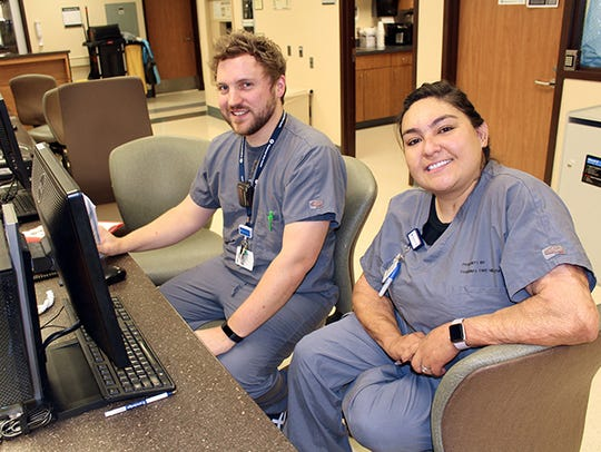 Nathan Crumley and Alejandra Vega provide care to patients