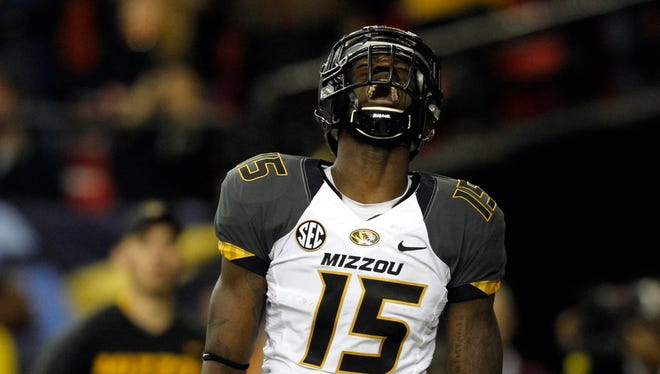 Missouri Tigers wide receiver Dorial Green-Beckham celebrates his touchdown reception against the Auburn Tigers during the first quarter of the 2013 SEC Championship game at Georgia Dome.