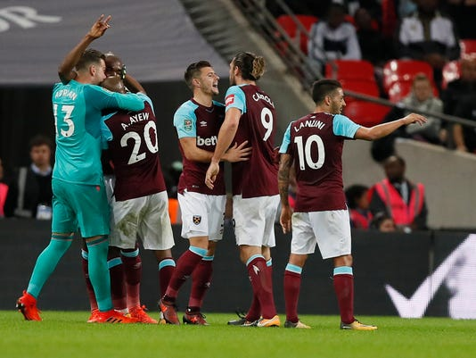 West Ham's players celebrate their side's third goal during the English League Cup soccer match between Tottenham Hotspur and West Ham at Wembley stadium in London, Wednesday, Oct. 25, 2017. (AP Photo/Kirsty Wigglesworth)