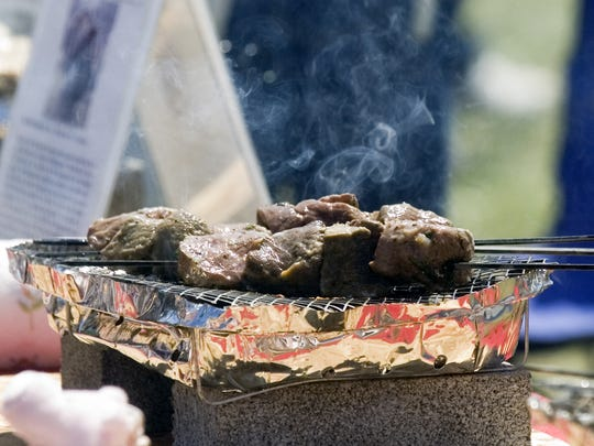 Spiedies are cooked for competition on tabletop grills during the Spiedie Fest and Balloon Rally in Binghamton.