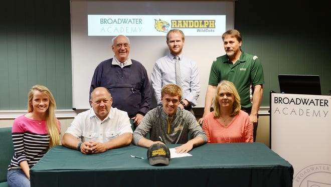 Broadwater Academy senior Drew Harman, center, has signed with Randolph College in Lynchburg, Va. to compete in cross country in the fall. Pictured with him are, from left, Katie Wendell, Brian Harman, Broadwater Headmaster Joe Spagnolo, Head track coach Eric Hack, Lisa Harman and Athletic Director Ron Anson.