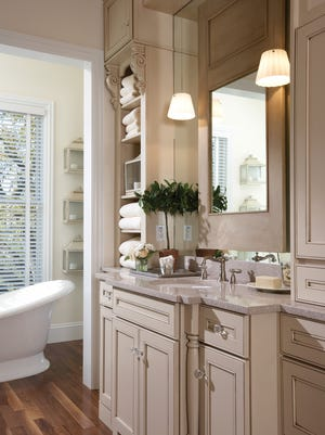 Custom, solid-wood cabinets are a hallmark of higher-end renovations. Many homeowners remove their built-in bath and replace it with a standalone tub when they remodel.