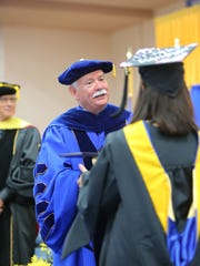 Dr. Stephen Tallant, president of Texas A&M University-Kingsville, congratulates a graduate during the first of four commencement ceremonies Friday, May 12, 2017, and Saturday, May 13, 2017, at Texas A&M University-Kingsville.