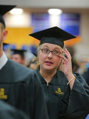 Anneka Traylor wipes away tears as she prepares to receive her bachelor's degree in veterinary technology from Texas A&M University-Kingsville during one of four commencement ceremonies hosted Friday, May 12, 2017, and Saturday, May, 13, 2017.