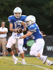 Jackson Christian;'s Gunnar Lewis hands the ball off to Luke Robertson against TCA on Aug. 18, 2017.