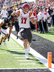 Kyle Kempt runs toward the end zone against Texas Tech.