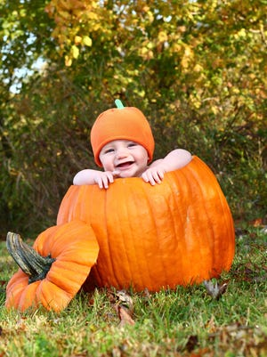 A baby pumpkin photo is a great way to capture memories of your little one.