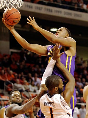 LSU Tigers forward Jarell Matin (1) is fouled by Auburn Tigers guard KT Harrell (1) during the first half at Auburn Arena. Mandatory Credit: John Reed-USA TODAY Sports