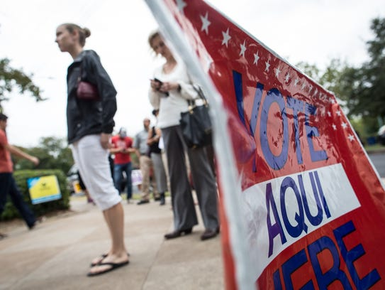 Voters wait in line to cast ballots in Austin, Texas.