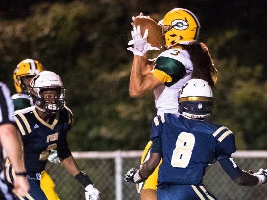 Crest High School's Lannden Zanders jumps to make a