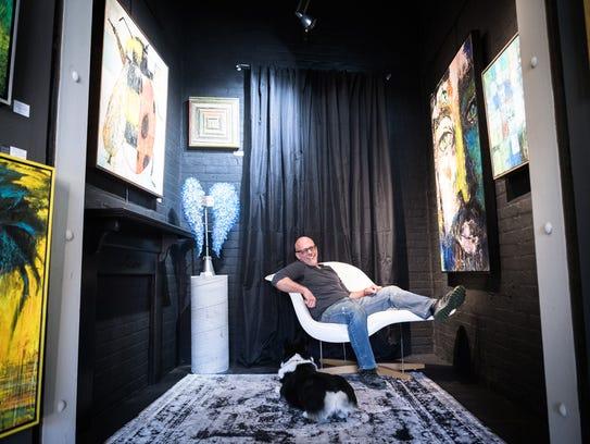 Mark Bettis, a fine art painter, in his studio in the