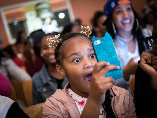 Johanna Jeter, 8, reacts to a performance at the fourth