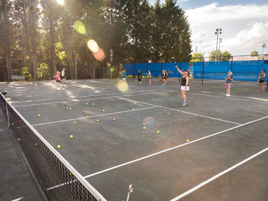 Students in the Try Tennis program offered by the Asheville