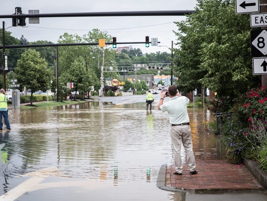 Flooding at the intersection of Biltmore Avenue and Lodge Street in Biltmore Village on Wednesday, May 30, 2018. The streets are flooded as a result of heavy rain throughout Western North Carolina.