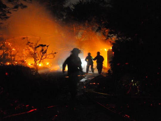 Indialantic firefighters, with an assist from Satellite Fire Dept. fight a house fire  in beachside Brevard County, between the two cities during Hurricane Matthew.