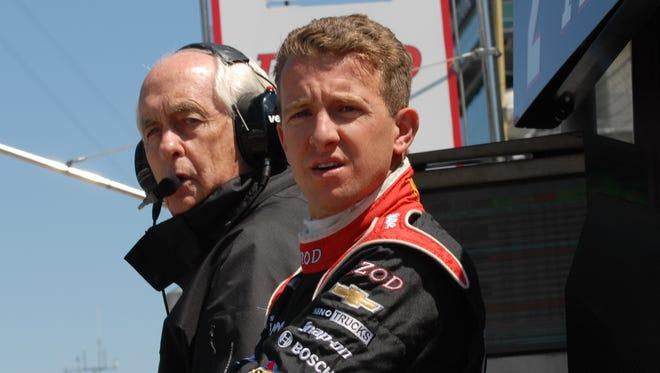 Team owner, Roger Penske, and Penske rookie driver, A. J. Allmendinger, watch final practice on Carb Day at the Indianapolis Motor Speedway.