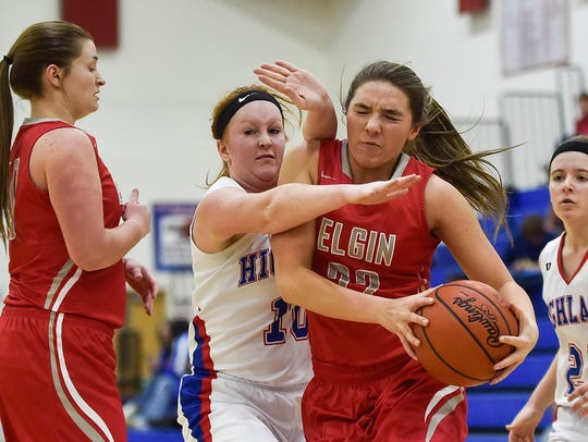 Elgin's Bekah Muselin drives to the basket at Highland last season. The Comets will compete in the Northwest Central Conference for the first time this season under new coach Bob Douds.