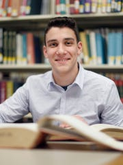 Mendel Taub studying in the Mortola Library at Pace University, where he is a political science major on full scholarship