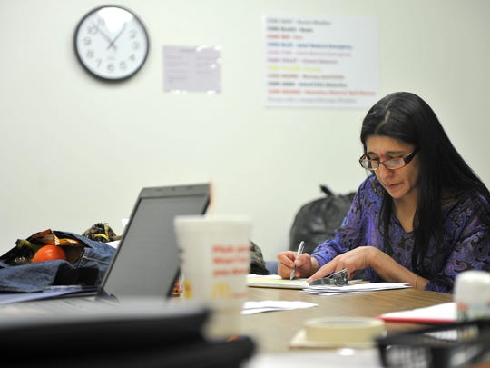 Farrah Long, 37, works on her practicum Friday afternoon during an internship at Progress Industries. Long is working toward an associate degree in human services through North Central State College. Her goal is to become a drug and alcohol counselor.