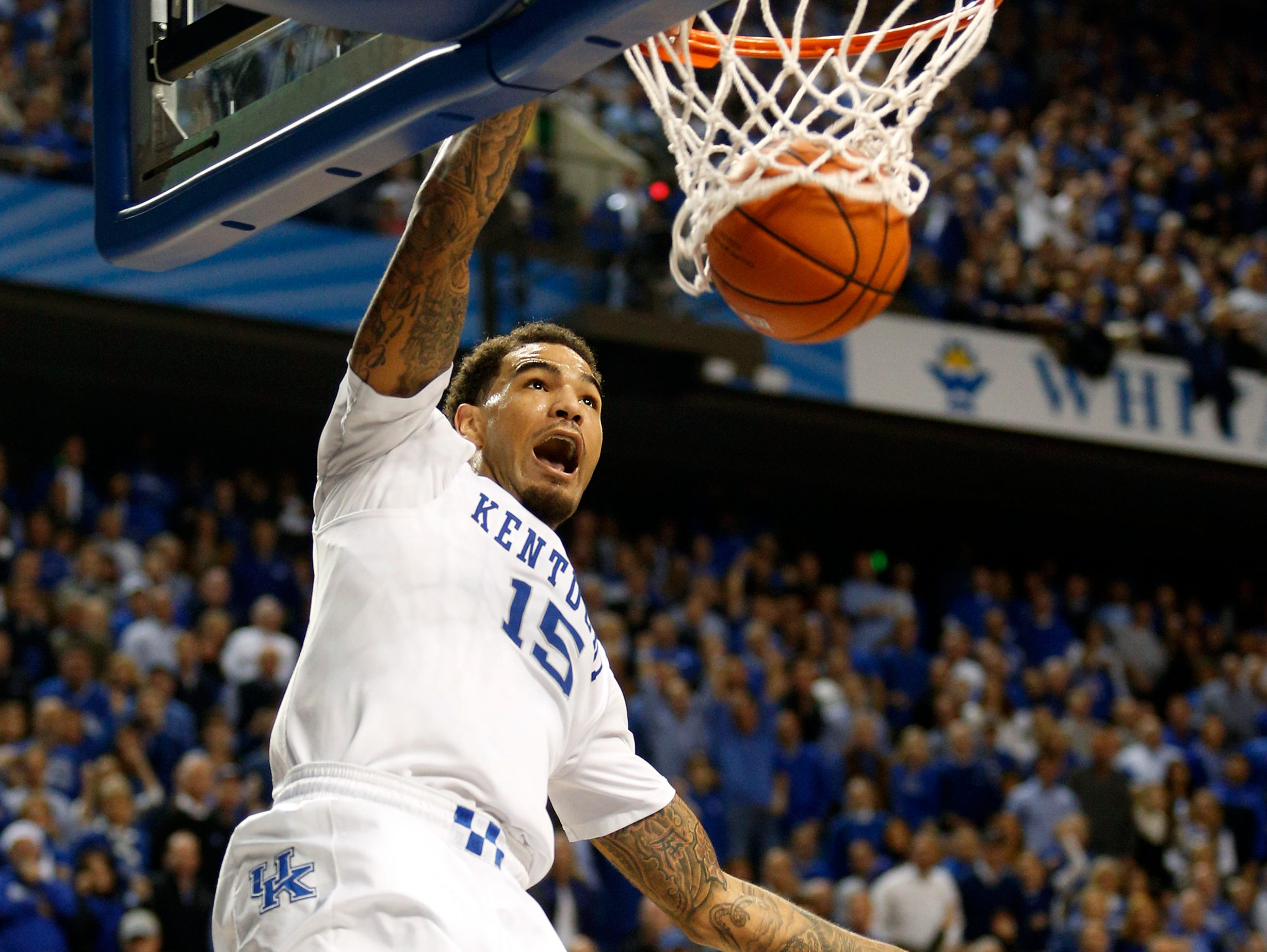 Kentucky's Willie Cauley-Stein gets a breakaway slam dunk against North Carolina. Cayley-Stein had 15 points, 4 steals and 6 rebounds. Dec. 13, 2014