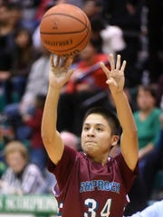 Shiprock's Landon Henderson takes a shot against Farmington on Jan. 26 at Scorpion Gym in Farmington.