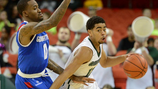University of Wisconsin-Green Bay's Carrington Love drives around Georgia State's Kevin Ware during the game at the Resch Center, Saturday, December 27, 2014. H. Marc Larson/Press-Gazette Media/@HMarcLarson
