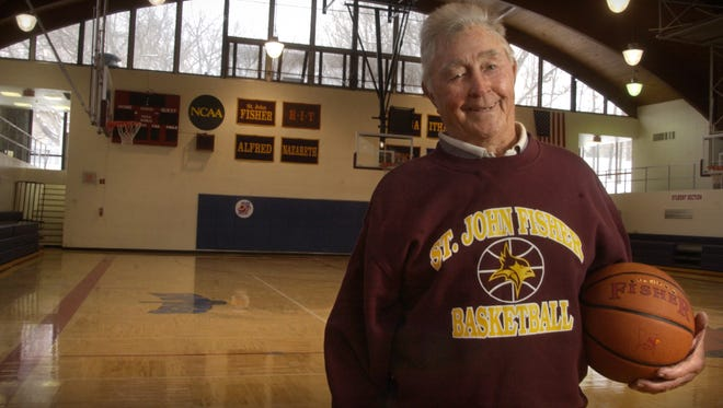 Bobby Wanzer, former St. John Fisher College basketball coach and a member of the Naismith Memorial Hall of Fame, stands on the basketball court at St. John Fisher College on Feb. 10, 2006 in Pittsford.