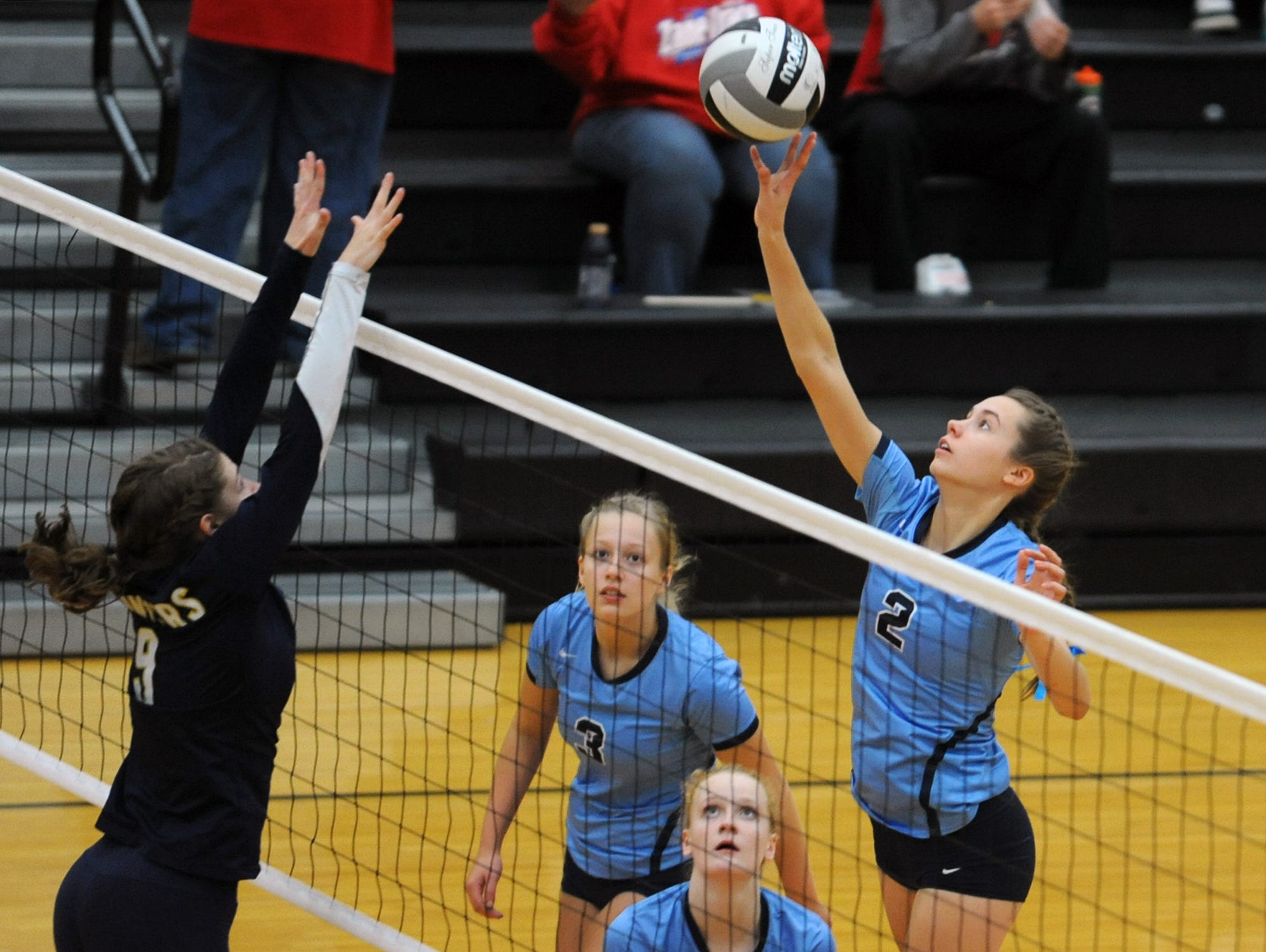 Adena's Carissa Poehler tips the ball over a South Point opponent Wednesday at Waverly High School. Adena defeated South Point 3-0.