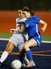 Binghamton's Olivia Pilotti and Horseheads' Skyler Roberts battle for the ball during the game on October 3, 2017. Horseheads won 4-1.