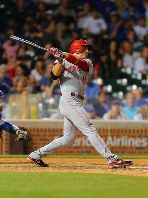 Cincinnati Reds first baseman Joey Votto (19) hits a single.