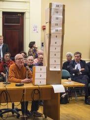 Jay Vos, left, speaks at a Burlington City Council