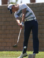 Charlie Reiter tees off while playing in the AJGA tournament