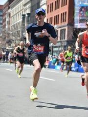 Rob Lee runs April 18 during the 120th Boston Marathon.
