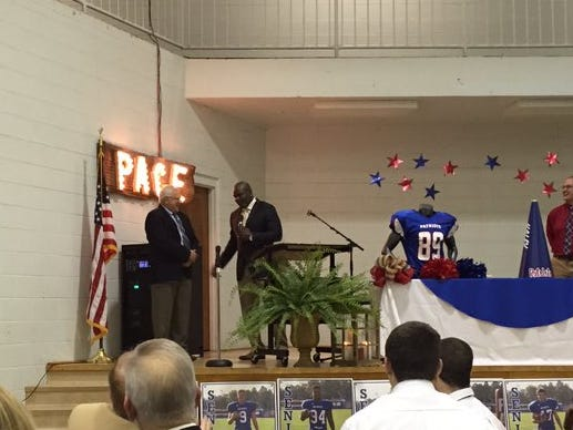 Former Pace High School football coach Mickey Lindsey, left, honored by NFL Hall of Famer and Escambia grad Emmitt SMith on Sunday.