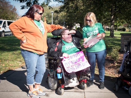 Cedar Haven resident Steve Nelson joins Amy Rittle and Wendy Viramontes on the picket line.
