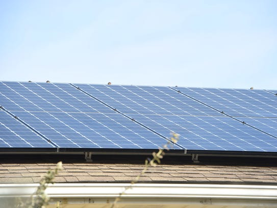 A closeup of the solar panels on a home in the Town