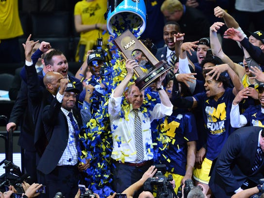 Michigan coach John Beilein celebrates with his team after beating Florida State to win a trip to the 2018 Final Four.