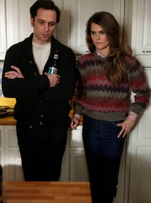 Matthew Rhys and Keri Russell as Philip and Elizabeth Jennings, a couple of KGB sleeper spies pretending to be ordinary suburban Yanks, in FX's 'The Americans.'