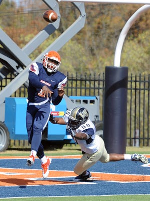 Carson-Newman quarterback Noah Suber gets chased out of the pocket by Wingate's Mackenzie Battle Saturday at Burke-Tarr Stadium in Jefferson City.