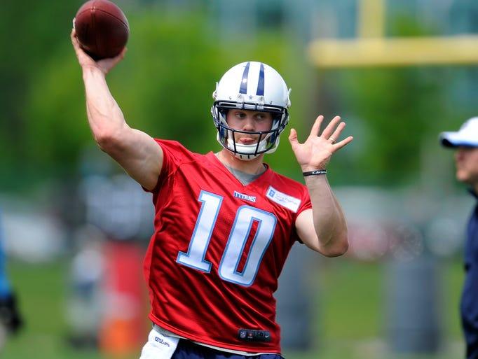 Titans quarterback Jake Locker throws a pass during practice at St. Thomas Sports Park Tuesday April 29, 2014, in Nashville, Tenn.