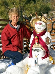 Deedee Tremblay tried to temper the celebration of the snow couple who visited their home north of Ruidoso.