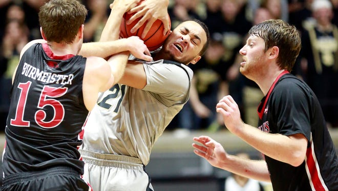 Purdue guard Kendall Stephens (21) pulls the ball away from Incarnate Word guard Sam Burmeister (15) while Incarnate Word guard Kyle Hittle watches in the first half of an NCAA college basketball game in West Lafayette, Ind., Wednesday, Nov. 18, 2015. (AP Photo/R Brent Smith)
