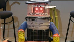 HitchBOT, a hitchhiking robot, is formally introduced