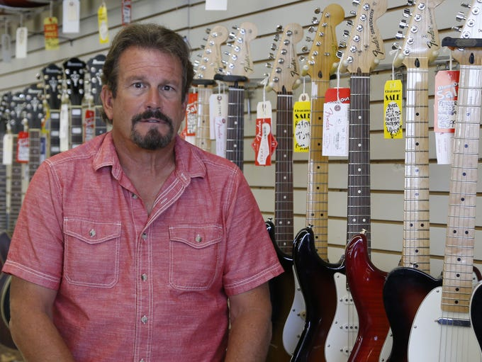 Bill Marinella, owner of Freehold Music, with instruments