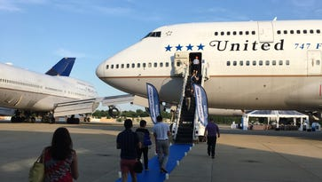 Would you bid 420,000 miles to see a parked plane? These frequent-fliers did
